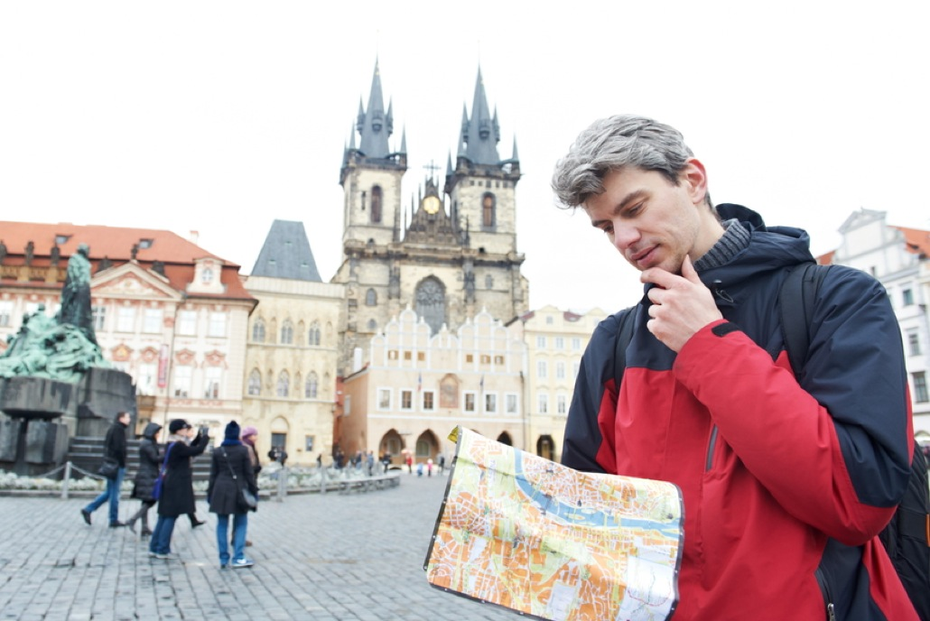 man with map over tourist attraction